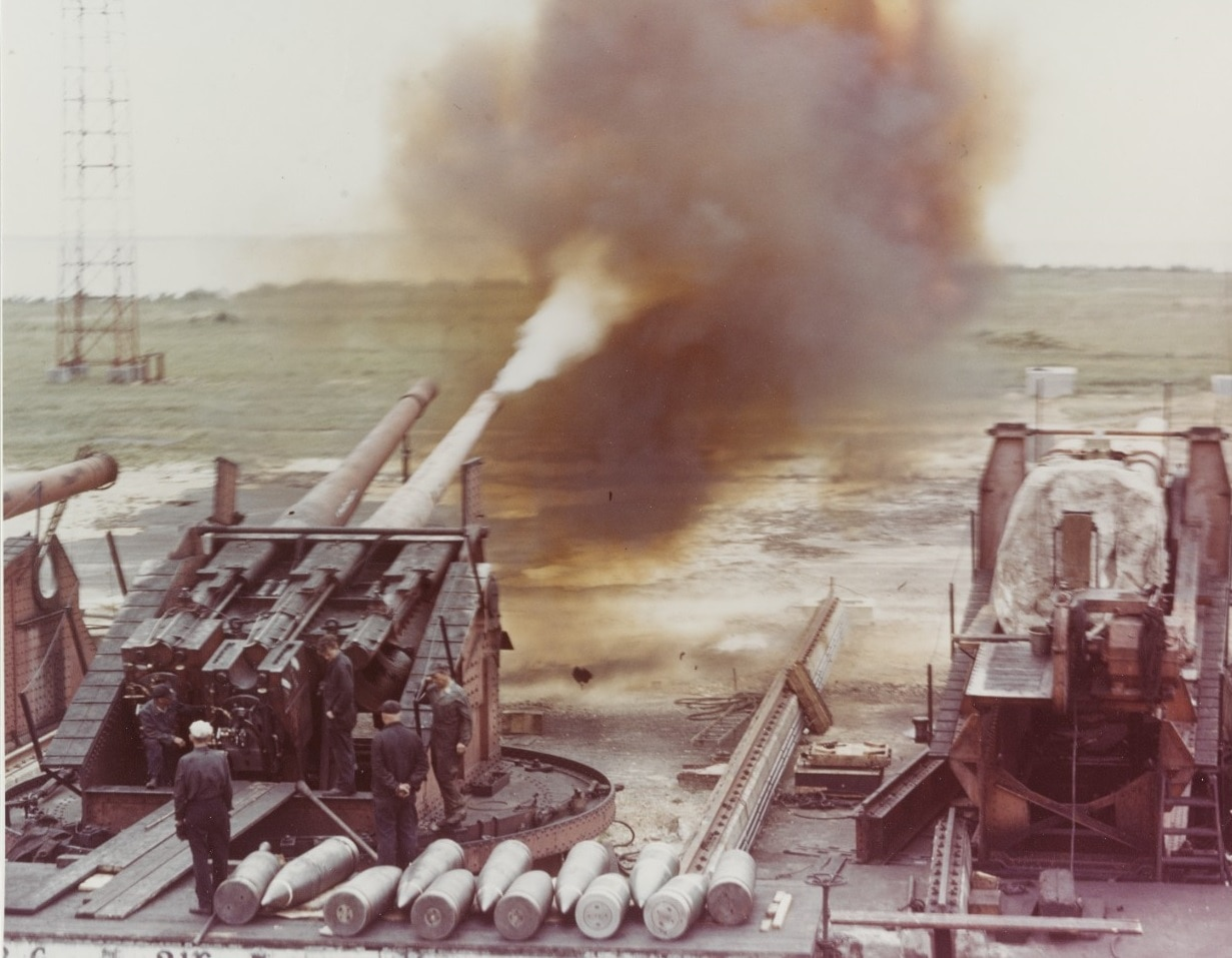 80-G-K-13599 Dahlgren Firing an eight-inch, 55-cal. Gun, during tests in World War II. This is a triple, single sleeve gun mount, with the right barrel removed