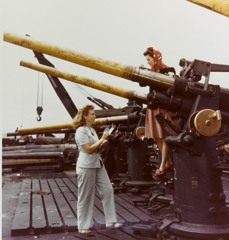 80-G-K-13604 Dahlgren A woman ordnance worker or wow writes down data from a sister employee concerning the 3 50 D.P. gun they have been test firing.